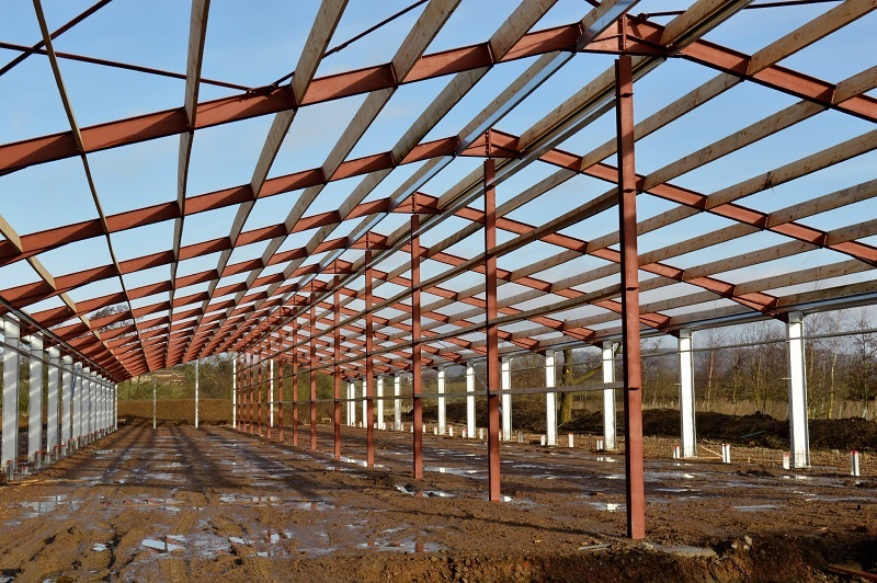 Steel structure farm building with timber purlins